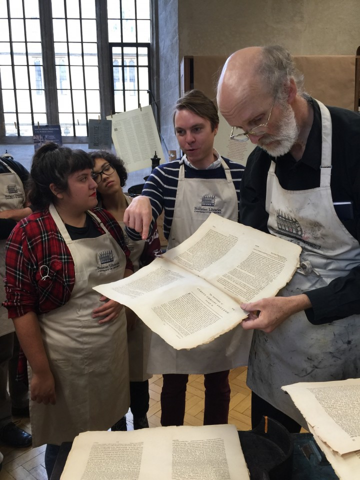 Columbia in London students looking at original manuscript at Bodleian Libraries in Oxford, UK