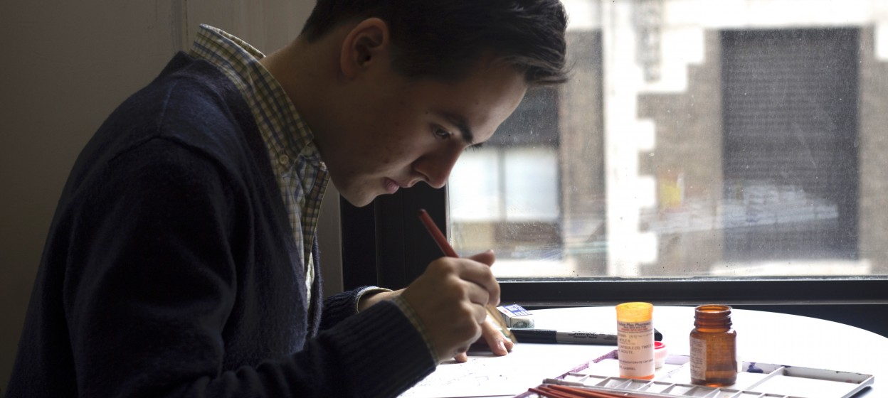 Myles Zhang working on a watercolor