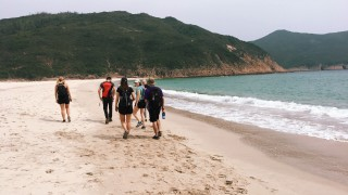 Students walking on beach