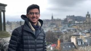 Eshan and the skyline of Edinburgh